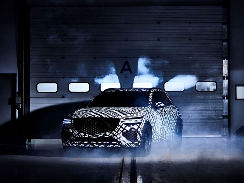 GENESIS REVEALS CAMOUFLAGED GV70  PREVIEWING THE BRAND NEW SUV